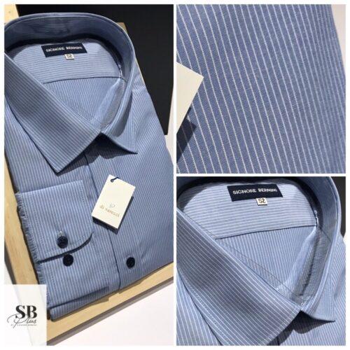 Camisa celeste raya clasica.